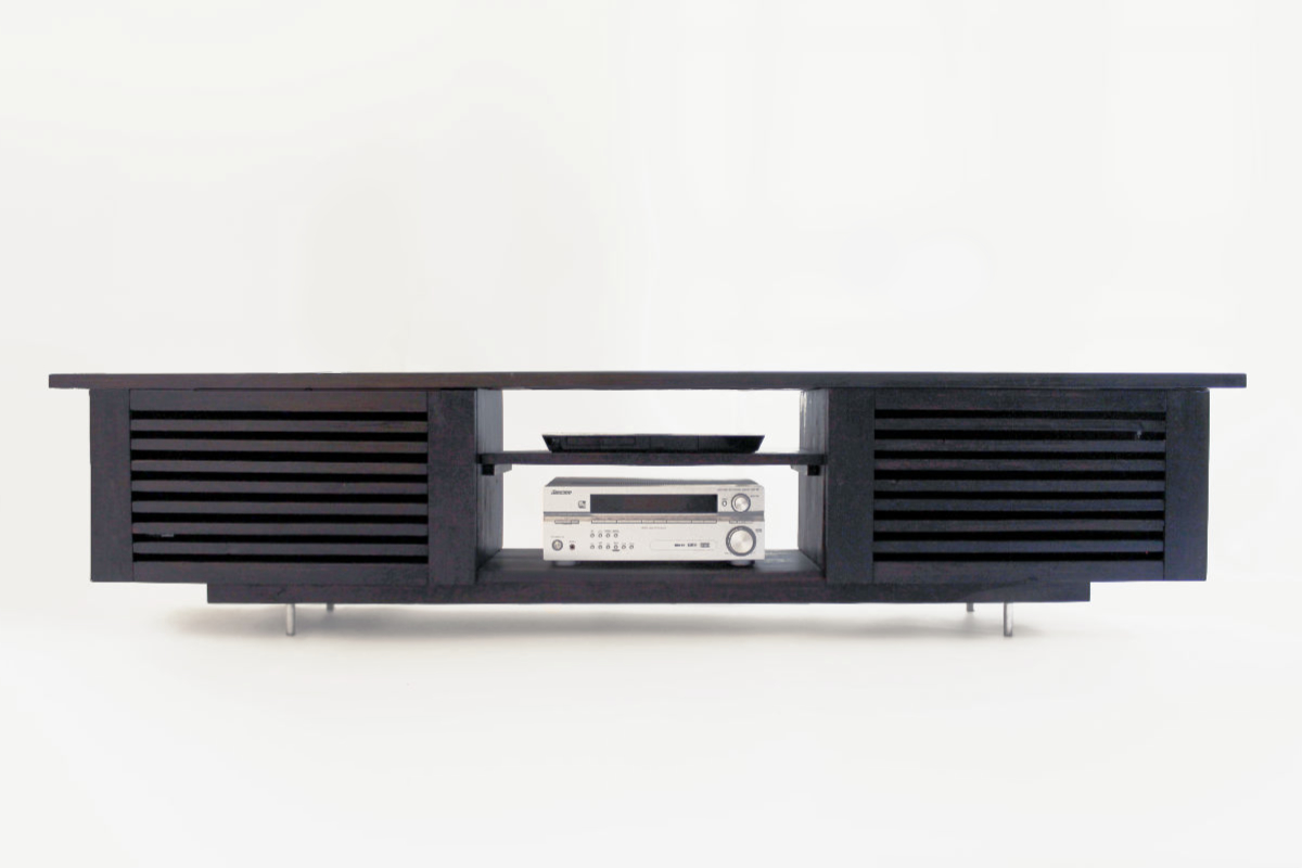This TV-stand was built in the customers garage from old worn leftover materials. The design is based on the wish to hide two big speakers behind the cabinet doors and still be able to play music through them. The old wood materials gave a rustic feeling for this cabinet designed for a home in the Finnish archipelago. Designed by Olli Karvonen